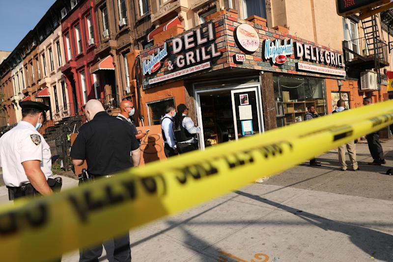 Police stand at the scene of a shooting which happened as Save Our Streets (S.O.S.) was holding a peace march last month in response to a surge in shootings in the Bedford Stuyvesant neighbourhood in Brooklyn, NY. Source: Getty
