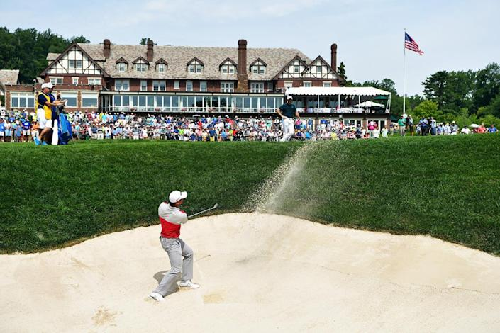 <p>Jason Day of Australia plays a shot from a bunker on the 18th hole during the first round of the 2016 PGA Championship at Baltusrol Golf Club on July 28, 2016 in Springfield, N.J.. (Photo: Stuart Franklin/Getty Images)</p>