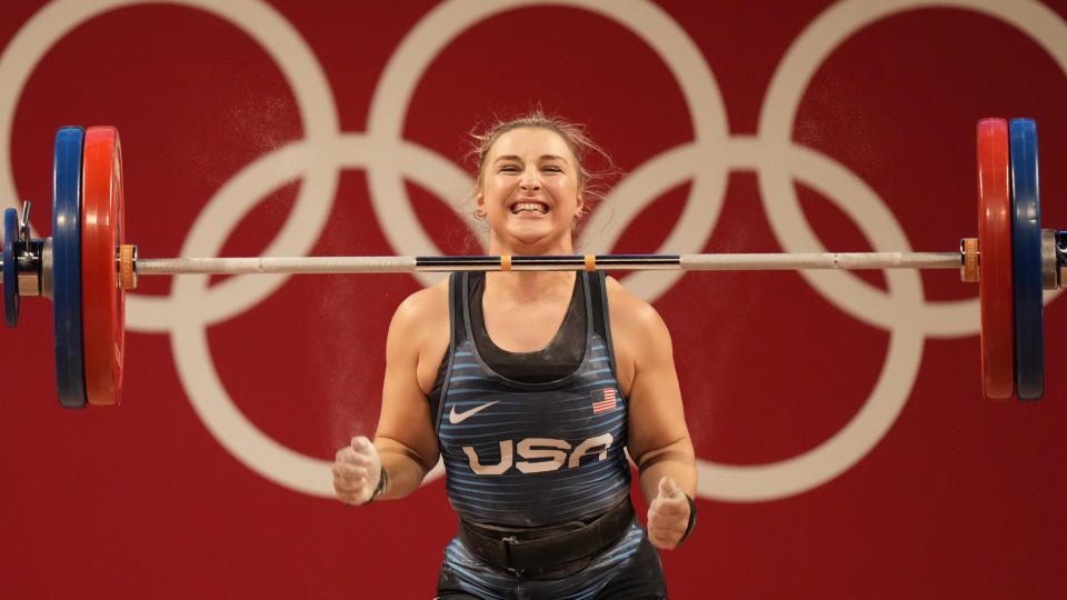 Katherine Elizabeth Nye of the United States celebrates after a lift, as she competes in the women's 76kg weightlifting event, at the 2020 Summer Olympics, Sunday, Aug. 1, 2021, in Tokyo, Japan. (AP Photo/Luca Bruno)
