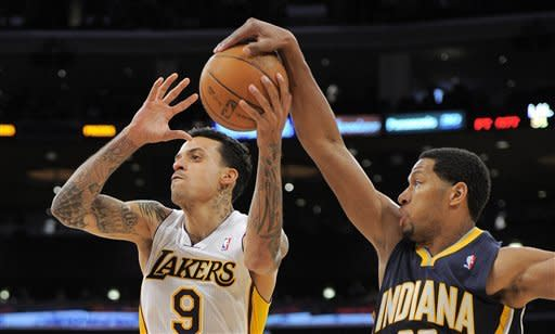 Los Angeles Lakers forward Matt Barnes has his pass blocked by Indiana Pacers forward Danny Granger during the second half of their NBA basketball game, Sunday, Jan. 22, 2012, in Los Angeles. The Pacers won 96-98. (AP Photo/Mark J. Terrill)