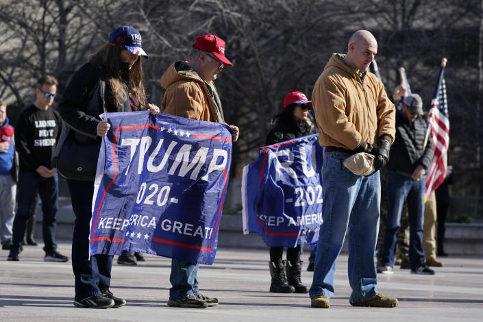 People take part in a rally at the Legislative Plaza, Wednesday, Jan. 6, 2021, in Nashville, Tenn. Two Tennessee lawmakers organized a prayer rally on Wednesday timed to coincide with a protest in the nation's Capitol in support of President Donald Trump's baseless claims that he won reelection. (AP Photo/Mark Humphrey)