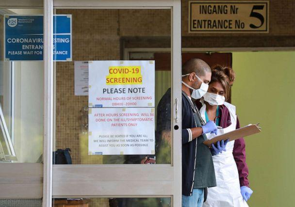 PHOTO: Medical workers check a file at a testing center at Tygerberg Hospital in Cape Town, South Africa, on April 6, 2020, as the country continued its 21-day nationwide lockdown in an effort to control the spread of the novel coronavirus. (Nardus Engelbrecht/AP)