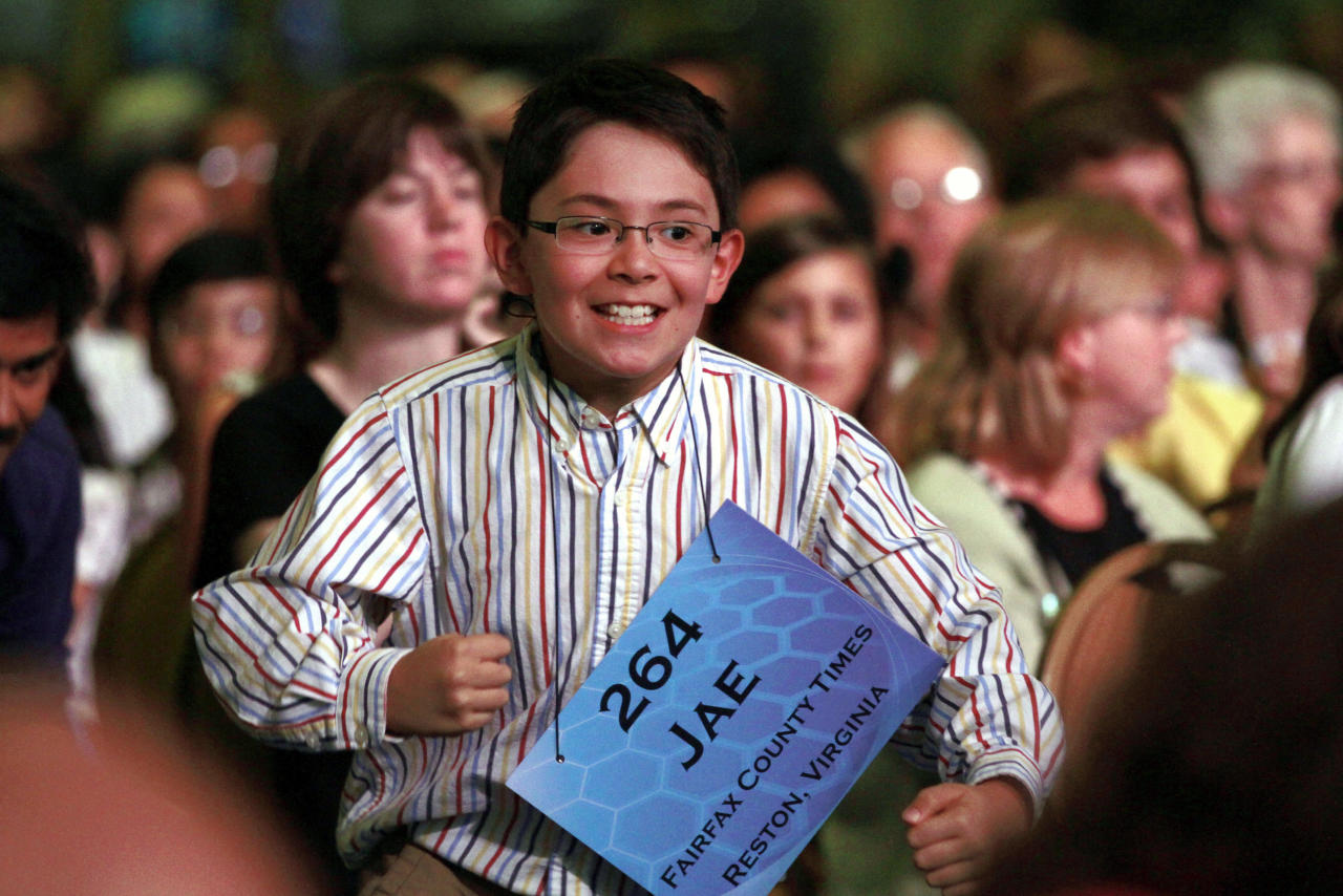 Jae Canetti, 10, of Fairfax, Va., jumps out of his seat as he is announced as one of the 50 semifinalists in the National Spelling Bee, in Oxon Hill, Md., on Wednesday, May 30, 2012.  (AP Photo/Jacquelyn Martin)