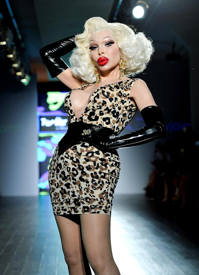 <p>Trans icon Amanda Lepore walked the Tumbler and Tipsy runway, and her signature red lip and falsies inspired the beauty look for the other models as well. (Photo: Getty Images) </p>