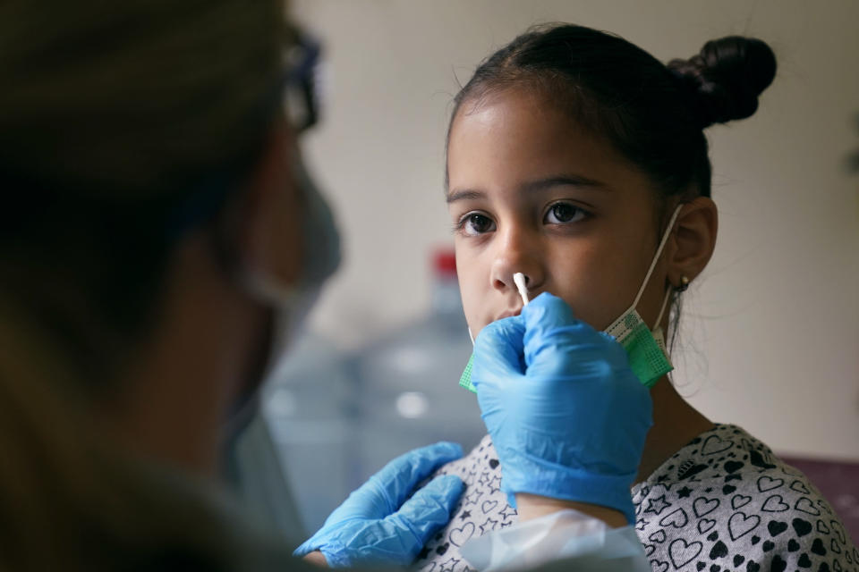A summer school student is tested for COVID-19 in the nurses office at the E.N. White School in Holyoke, Mass., on Wednesday, Aug. 4, 2021. Schools across the U.S. are about to start a new year amid a flood of federal money larger than they've ever seen before, an infusion of pandemic relief aid that is four times the amount the U.S. Department of Education sends to K-12 schools in a typical year. (AP Photo/Charles Krupa)