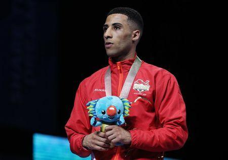 Boxing - Gold Coast 2018 Commonwealth Games - Men's 46-49kg - Victory Ceremony - Oxenford Studios - Gold Coast, Australia - April 14, 2018. Galal Yafai of England with his bronze medal. REUTERS/Athit Perawongmetha