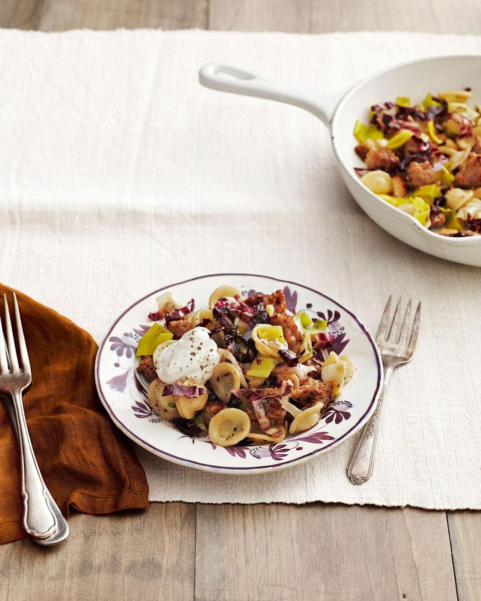 """<p>Seasoned ground turkey and a fat-free ricotta make this complex, flavorful pasta dish wow-worthy. </p><p><strong><a href=""""https://www.countryliving.com/food-drinks/recipes/a4858/orecchiette-sausage-radicchio-recipe-clv0214/"""" rel=""""nofollow noopener"""" target=""""_blank"""" data-ylk=""""slk:Get the recipe"""" class=""""link rapid-noclick-resp"""">Get the recipe</a>.</strong></p><p><a class=""""link rapid-noclick-resp"""" href=""""https://www.amazon.com/Patented-Strainer-Handles-Nonstick-Ti-Cerama/dp/B071L32Q8W/?tag=syn-yahoo-20&ascsubtag=%5Bartid%7C10050.g.31929300%5Bsrc%7Cyahoo-us"""" rel=""""nofollow noopener"""" target=""""_blank"""" data-ylk=""""slk:SHOP PASTA POTS"""">SHOP PASTA POTS</a></p>"""