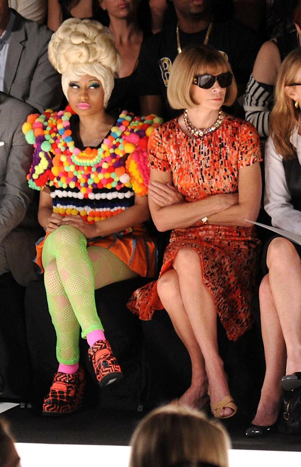 "Perhaps it's just me, but I think this is the best picture EVER. On the right, we have <i>Vogue</i>'s icy editor-in-chief Anna Wintour, who paired her signature helmet hair and shades with a sensible frock. And, on the left, we have ""Super Bass"" songstress (and fashionista wannabe) Nicki Minaj, who clearly threw some shade Anna's way while sitting next to her at designer Carolina Herrera's Fashion Week presentation. Mike Coppola/<a href=""http://www.gettyimages.com/"" target=""new"">GettyImages.com</a> - September 12, 2011"