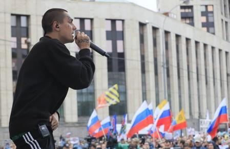 Russian rapper Face performs during a rally to demand authorities allow opposition candidates to run in a local election in Moscow