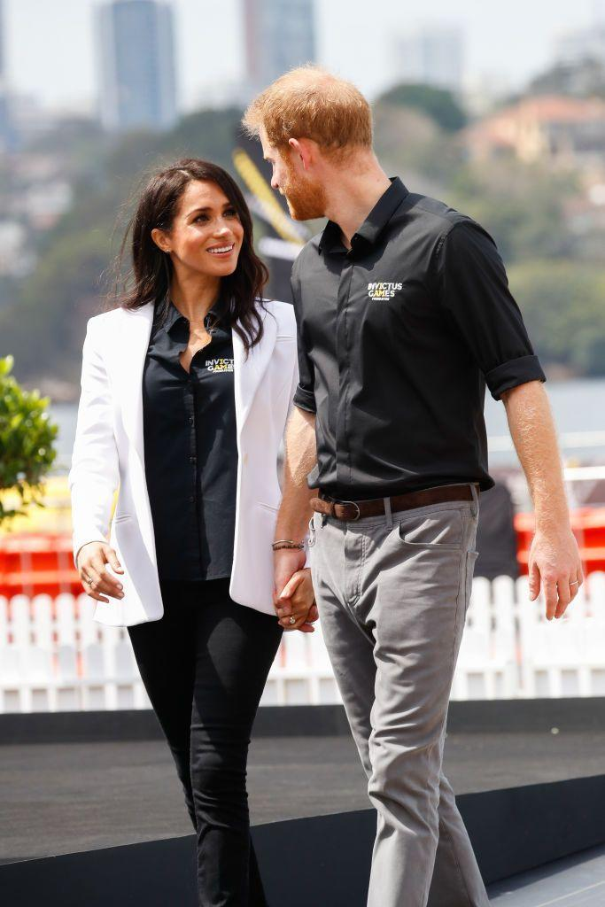"<p>On Day 5 of their Royal Tour, Harry and Meghan attended the <a href=""https://www.townandcountrymag.com/society/tradition/g23936092/meghan-markle-prince-harry-australia-day-5-invictus-games-opening-ceremony-sydney-2018-photos/"" rel=""nofollow noopener"" target=""_blank"" data-ylk=""slk:JLR Drive Day"" class=""link rapid-noclick-resp"">JLR Drive Day</a> at Cockatoo Island where they handed out awards for a driving challenge. </p>"