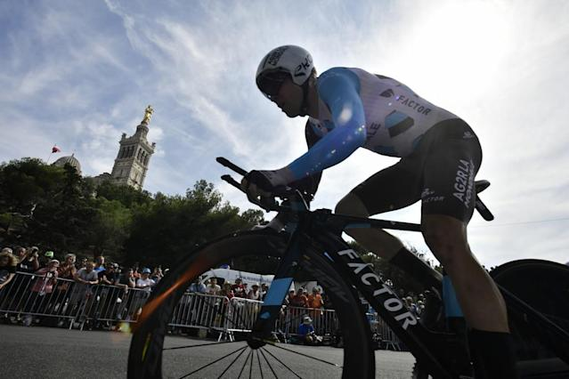 Belgium's Jan Bakelants rides past the Notre-Dame de la Garde basilica (L) as he competes in a 22,5 km individual time-trial, the twentieth stage of the 104th edition of the Tour de France cycling race on July 22, 2017 in and around Marseille, southern France. (AFP Photo/Jeff PACHOUD)