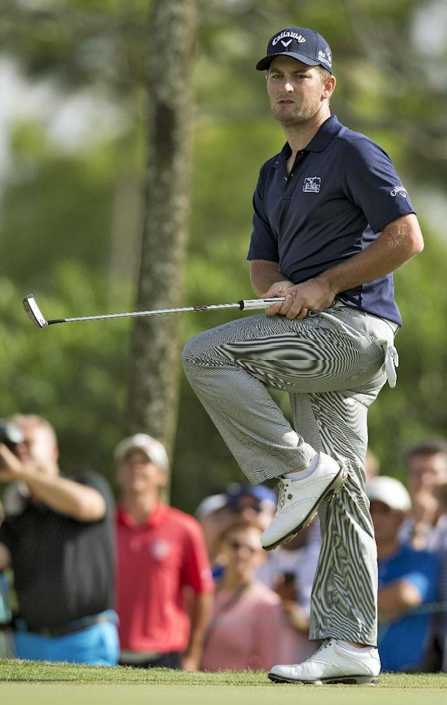 Matt Every kicks up his leg as he misses a putt on the 14th hole during the final round of the Arnold Palmer Invitational golf tournament at Bay Hill, Sunday, March 23, 2014, in Orlando, Fla. Every went onto win the tournament. (AP Photo/Willie J. Allen Jr.)