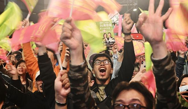Supporters of Taiwan President Tsai Ing-wen celebrate outside her party's campaign headquarters in Taipei. Photo: AFP