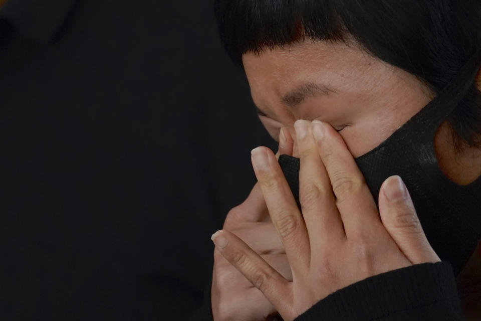 Hong Kong journalist Choy Yuk-ling, also known as Bao Choy, reacts outside a court in Hong Kong Thursday, April 22, 2021. A Hong Kong journalist was fined 6,000 Hong Kong dollars ($775) on Thursday after being found guilty of making false statements while obtaining information from a vehicle database, in the latest blow to press freedom in the city as authorities continue their crackdown on dissent. (AP Photo/Kin Cheung)
