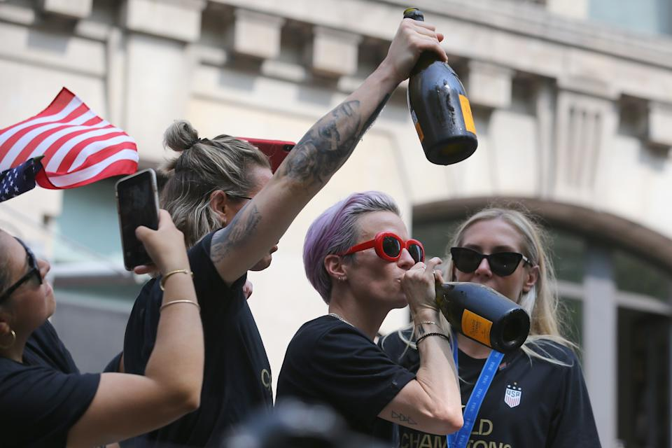 Megan Rapinoe takes a drink of the bubbly as the U.S. women's soccer team is celebrated with a parade along the Canyon of Heroes, Wednesday, July 10, 2019, in New York. (Photo: Gordon Donovan/Yahoo News)
