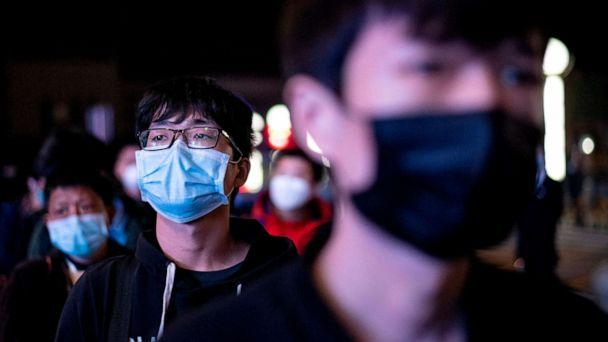 PHOTO: Passengers wear facemasks as they form a queue at the Wuhan Wuchang Railway Station in Wuhan, early April 8, 2020, as they prepare to leave the city in China's central Hubei province.  (Noel Celis/AFP via Getty Images)