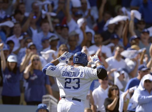 Los Angeles Dodgers' Adrian Gonzalez reacts after hitting a home run during the third inning of Game 5 of the National League baseball championship series against the St. Louis Cardinals Wednesday, Oct. 16, 2013, in Los Angeles. (AP Photo/Mark J. Terrill)
