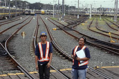 Workers inspect tracks on a railway at a depot of Southeast Asia's first light rail transit (LRT) network, which is 29-years-old, in Manila October 10, 2013. REUTERS/Erik De Castro