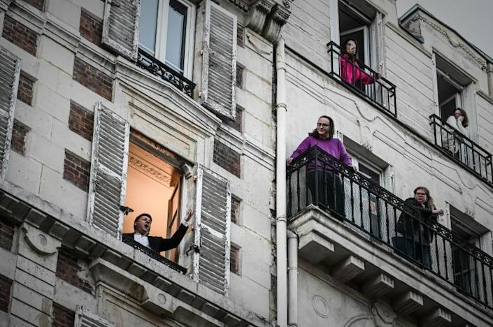 Tenor Stephane Senechal throws open the window of his Paris apartment every night at 7pm and lets fly with an aria to the delight of neighbours (AFP Photo/PHILIPPE LOPEZ)