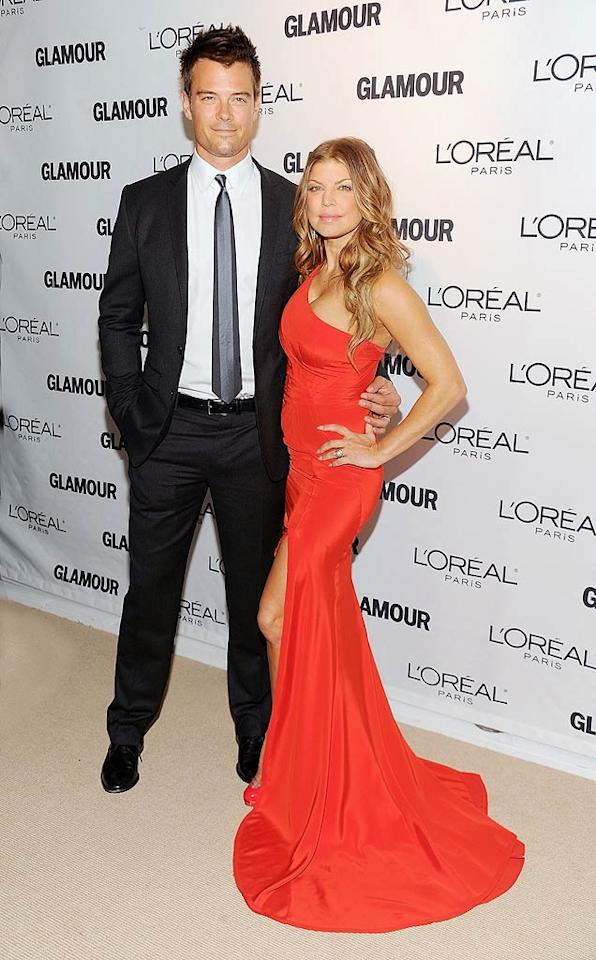 "Va-va-voom! Fergie knocked it out of the park with her sexy one-shoulder Zac Posen gown at the <i>Glamour</i> Women of the Year Awards. But her arm candy, hot hubby Josh Duhamel, was the Black Eyed Peas singer's best accessory! Dimitrios Kambouris/<a href=""http://www.wireimage.com"" target=""new"">WireImage.com</a> - November 8, 2010"