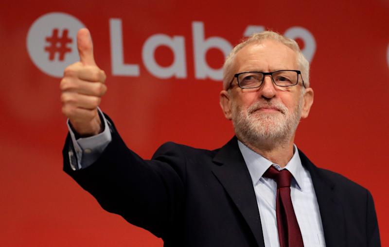 Jeremy Corbyn reacts to the news with a thumbs up (AP)