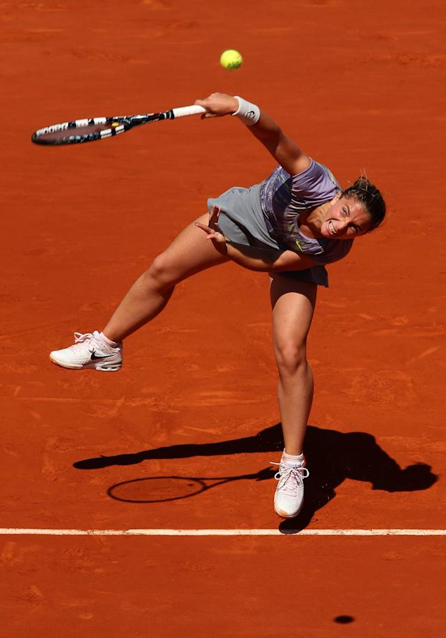 PARIS, FRANCE - JUNE 04: Sara Errani of Italy serves during her Women's Singles quarter-final match against Agnieszka Radwanska of Poland on day ten of the French Open at Roland Garros on June 4, 2013 in Paris, France. (Photo by Clive Brunskill/Getty Images)