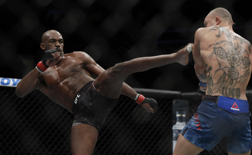 UFC light heavyweight champion Jon Jones kicks Anthony Smith during their bout that Jones won by unanimous decision at UFC 235 in Las Vegas on March 6. Jones will next defend his belt against Thiago Santos on July 6 in Las Vegas. (Getty Images)