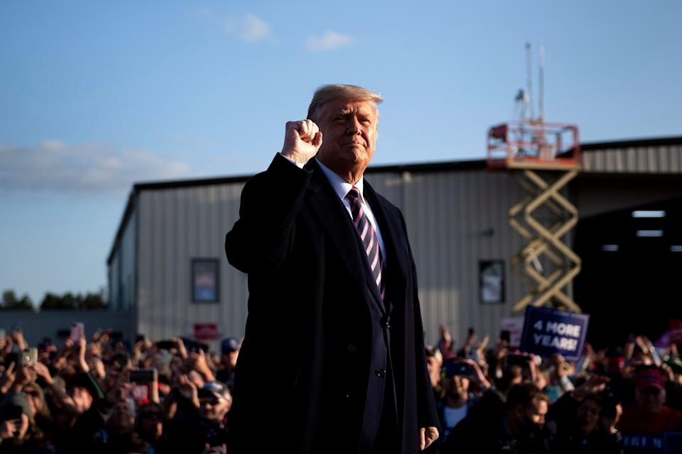 """President Donald Trump pumps his fist as he arrives for a """"Great American Comeback"""" rally Friday in Bemidji, Minnesota. Trump may try to get a third Supreme Court nominee confirmed before the November election. (Photo: BRENDAN SMIALOWSKI/AFP via Getty Images)"""