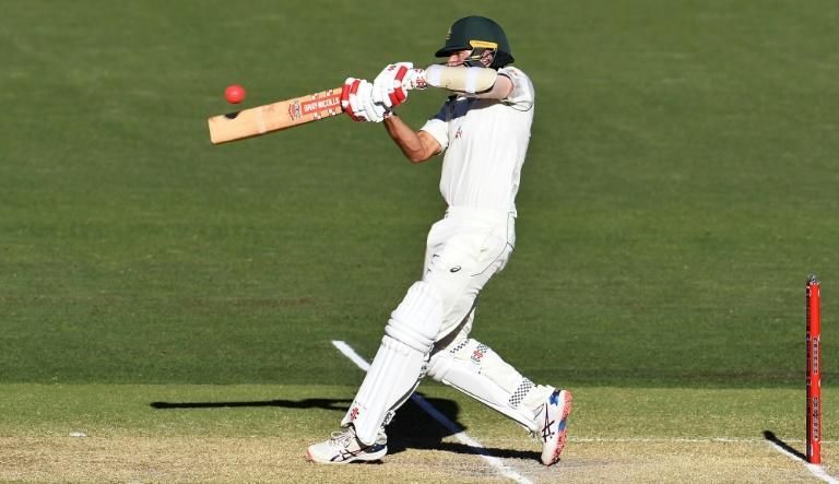 Australia's Joe Burns hits a six to bring up his 50 and victory for Australia on the third day of the first cricket Test match against India