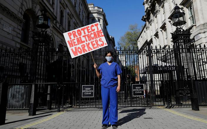 Doctor Meenal Viz protesting about the lack of PPE and protection for NHS health workers in April 2020 - Kirsty Wigglesworth/AP