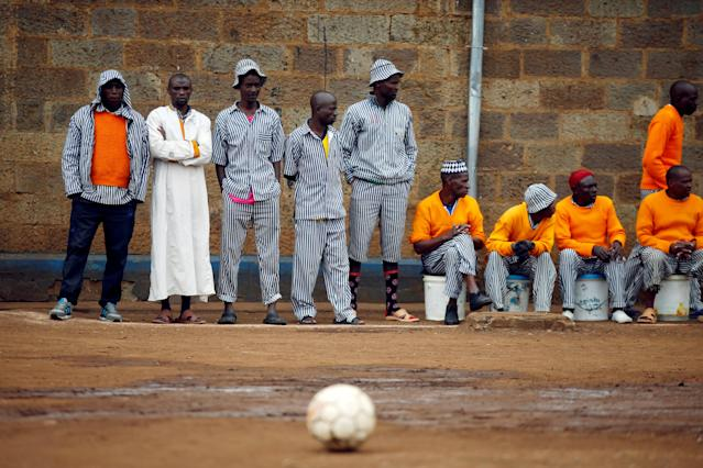 <p>Prisoners wait for the start of a mock World Cup soccer match between Russia and Saudi Arabia during a monthlong soccer tournament at the Kamiti Maximum Security Prison, near Nairobi, Kenya, on June 14, 2018. (Photo: Baz Ratner/Reuters) </p>