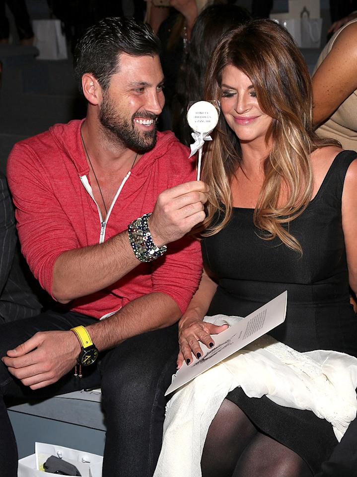 "Is it us or does Kirstie Alley not go anywhere without her ""Dancing With the Stars"" partner Maksim Chmerkovskiy anymore? The duo enjoyed the Zang Toi Spring 2013 show on Sunday. (9/9/2012)"
