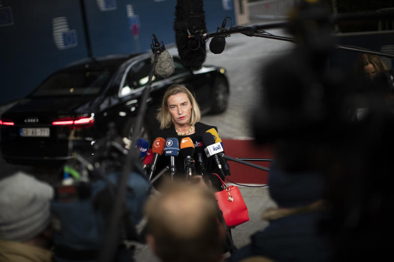 European Union Foreign Policy chief Federica Mogherini talks to journalists as she arrives to an European Foreign Affairs Ministers meeting at the Europa building in Brussels, Monday, Nov. 11, 2019. European Union foreign ministers are discussing ways to keep the Iran nuclear deal intact after the Islamic Republic began enrichment work at its Fordo power plant. (AP Photo/Francisco Seco)