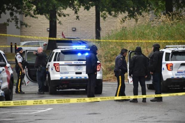 Surrey RCMP investigate a shooting near the Newton bus loop on Aug. 20, 2021 that sent one man to hospital with life-threatening injuries. Two are in custody. (Curtis Kreklau - image credit)