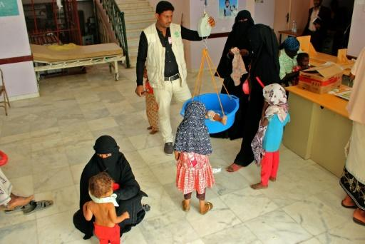 Children suffering from malnutrition receive treatment at a clinic in Yemen's northern Hajjah province