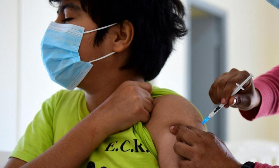 A minor receiving a Covid-19 vaccine in Asuncion, Paraguay. Pfizer and BioNTech have said trial results showed their coronavirus vaccine was safe and produced a robust immune response in children aged five to 11.