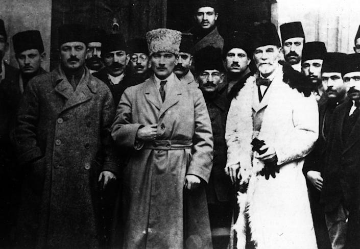 Mustafa Kemal Atatürk, center, future president of the Republic of Turkey, posing with some other people attending the Sivas Congress in the city of Sivas in September 1919. (Photo: Mondadori via Getty Images)