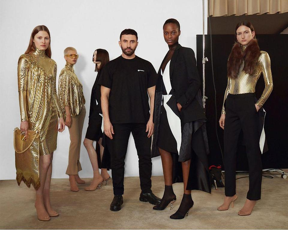 Riccardo Tisci stands among his leggy crew in the newest gold and bold Burberry creations.