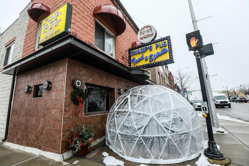 Patrons dine in an igloo outside of Champs Pub in Brighton, Mich., which has been selected to receive a financial lifeline from the Barstool fund founded by Dave Portnoy to aid small businesses struggling to stay afloat during the coronavirus pandemic.