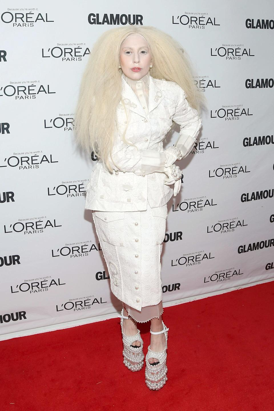 Gaga wears a white ensemble by Thom Browne, complete with powdered face and platinum wig, for the Glamour Women of the Year gala on Nov. 11, 2013.
