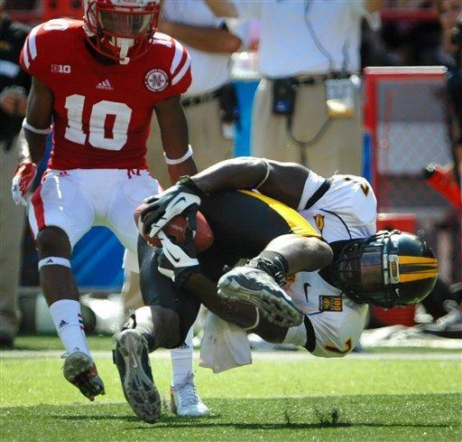 Southern Miss's Desmond Johnson tries to haul in a pass in front of Nebraska's Josh Mitchell (10) during an NCAA college football game, Saturday, Sept 1, 2012, in Lincoln, Neb. (AP Photo/Dave Weaver)