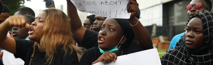 Nigerians take part in a protest against violence, extortion and harassment from Nigeria's Special Anti-Robbery Squad (Sars), in Lagos on 11 October 2020.