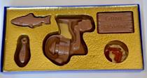 """<p><strong>ChocolatesUnlimited</strong></p><p>etsy.com</p><p><strong>$14.00</strong></p><p><a href=""""https://go.redirectingat.com?id=74968X1596630&url=https%3A%2F%2Fwww.etsy.com%2Flisting%2F274999720%2Fchocolate-fishing-chocolate-fathers-day&sref=https%3A%2F%2Fwww.delish.com%2Fholiday-recipes%2Fvalentines-day%2Fg994%2Fvalentines-day-chocolates%2F"""" rel=""""nofollow noopener"""" target=""""_blank"""" data-ylk=""""slk:BUY NOW"""" class=""""link rapid-noclick-resp"""">BUY NOW</a></p><p>Does your valentine love fishing? This handmade set will show them that they're a catch.</p>"""