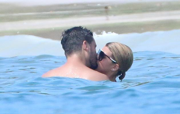 The couple were seen swimming together and indulging in some serious PDA. Source: Splash