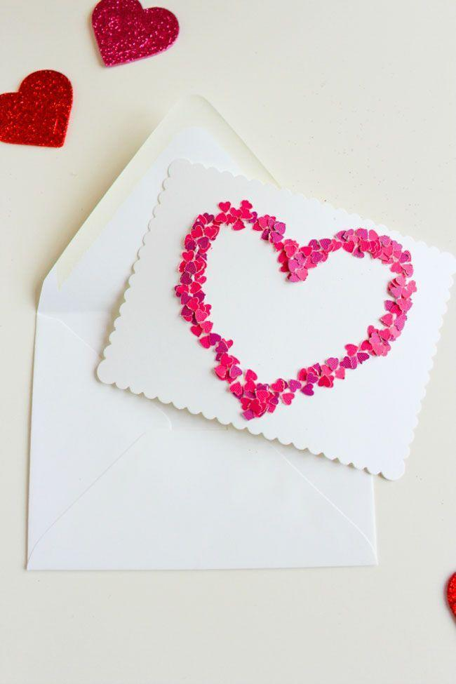 """<p>Kids will have a blast making these quick and easy Valentine cards. Use a hole puncher to create your festive confetti out of paper scraps. Draw an """"XO"""" (or any other design of your choice) using white glue and paste away.</p><p><em><a href=""""https://designimprovised.com/2013/02/diy-valentine.html"""" rel=""""nofollow noopener"""" target=""""_blank"""" data-ylk=""""slk:Get the how-to at Design Improvised»"""" class=""""link rapid-noclick-resp"""">Get the how-to at Design Improvised»</a></em></p>"""