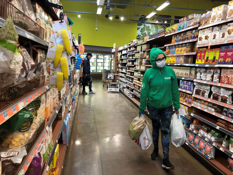 FILE PHOTO: Shoppers are seen at Whole Foods in Los Angeles, California