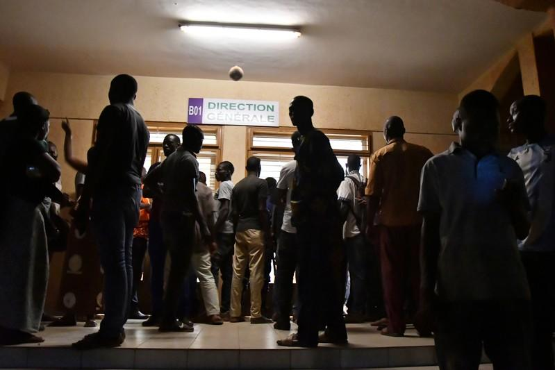 Family members of victims of an ambush on workers near a Canadian-owned mine, wait at Bogodogo in Ouagadougou