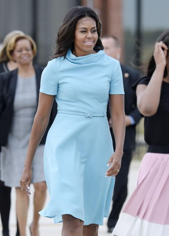 <p>Obama chose a dress from devout Catholic designer Carolina Herrera to meet with his Holiness for the first time during his visit stateside. She paired the electric blue belted piece with Jimmy Choo heels. </p>
