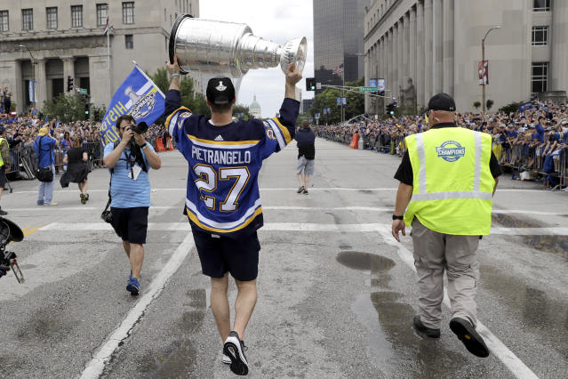 St. Louis Blues defenseman and captain Alex Pietrangelo carries the Stanley Cup during the Blues' NHL hockey Stanley Cup victory celebration in St. Louis on Saturday, June 15, 2019. (AP Photo/Darron Cummings)