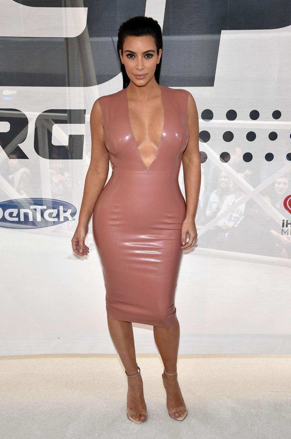 <p>Kim may make it look totally casual, but these bondage-inspired dresses are a bitch to get on. </p>